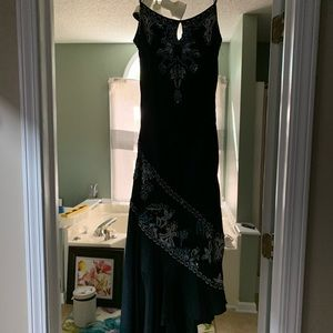 Black CACHE dress with beautiful beading detail;